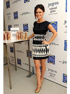 Rachel Bilson poses next to a display of Jergens products