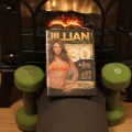 Photo of Jillian Michaels Ripped in 30 DVD with weights, a mat, and a fireplace background